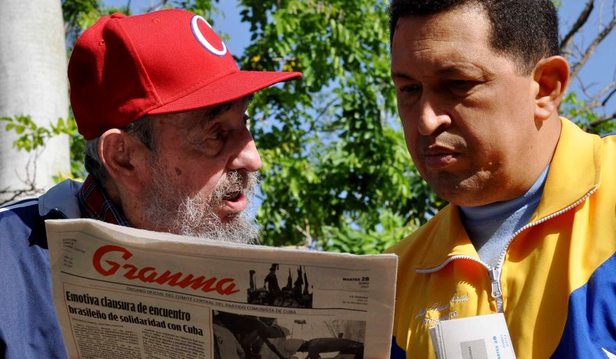 In this photo released by Granma newspaper, Cuba's Fidel Castro, left, and Venezuela's President Hugo Chavez look at Granma state newspaper in an unknown location in Havana, Cuba, on Tuesday, June 28, 2011. (AP Photo/Granma)