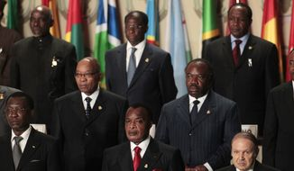 African heads of state and country representatives stand during the opening session of the 17th African Union Summit, at Sipopo Conference Center, outside Malabo, Equatorial Guinea, Thursday, June 30, 2011. Heads of state pictured are, front row, from left, Chad President Idriss Deby, Congo President Denis Sassou-Nguesso, and Algerian President Abdelaziz Bouteflika; second row, from left, South African President Jacob Zuma and Gabon President Ali Bongo Ondimba. (AP Photo/Rebecca Blackwell)