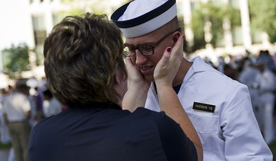 Naval Academy Plebe Brandon Hudson is embraced by his mother Tracy Hudson after during the Oath of Office Ceremony, on Induction Day at the U.S. Naval Academy, in Annapolis, Md., Thursday, June 30, 2011. Induction Day marks the day the young men and women begin their transformation from civilians to midshipmen and begin their Plebe Summer training program. (Drew Angerer/The Washington Times)