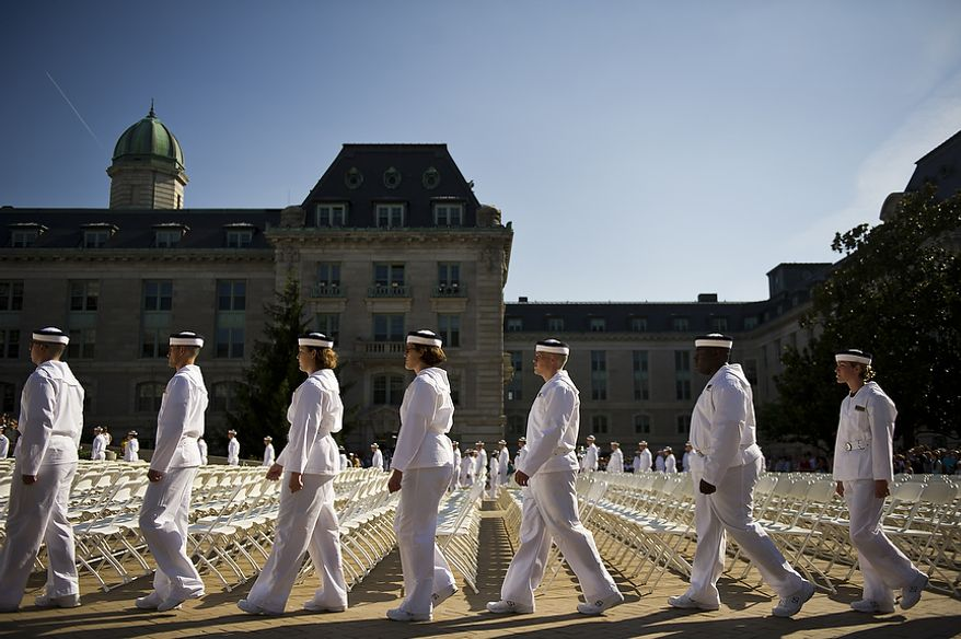 Incoming Naval Academy Plebes walk to their seats for the Oath of Office Ceremony, in Tecumseh Court, the courtyard of Bancroft Hall, on Induction Day at the U.S. Naval Academy, in Annapolis, Md., Thursday, June 30, 2011. Induction Day marks the day the young men and women begin their transformation from civilians to midshipmen and begin their Plebe Summer training program. (Drew Angerer/The Washington Times)
