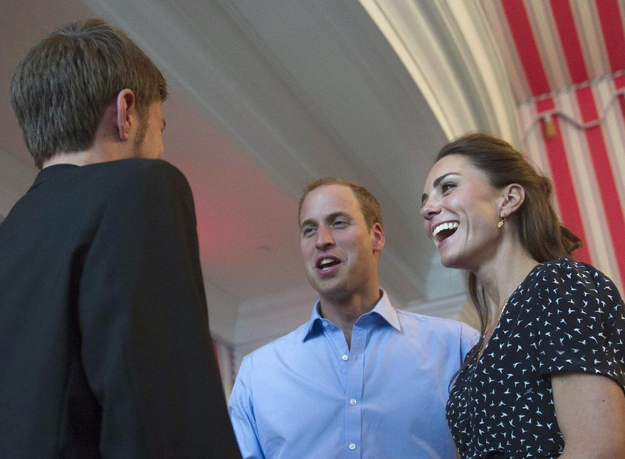 Prince William and wife Kate, the Duke and Duchess of Cambridge, smile as they meet with people at a youth event in Ottawa on June 30, 2011. (Associated Press/The Canadian Press)
