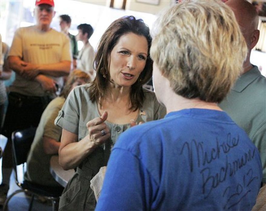 Republican presidential candidate Michele Bachmann, left, speaks with Sheila Reiland of Iowa City, Iowa, during a breakfast chat at the Bluebird Diner on Saturday, July 2, 2011, in Iowa City. The event kicks off Bachmann's Iowa Bus Tour. (AP Photo/The Gazette, Jim Slosiarek)