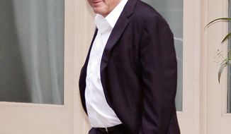 Dominique Strauss-Kahn, right, former head of the IMF, leaves his house for the first time after the judge changed the terms of his house arrest, Friday, July 1, 2011, in New York. (AP Photo/David Karp)
