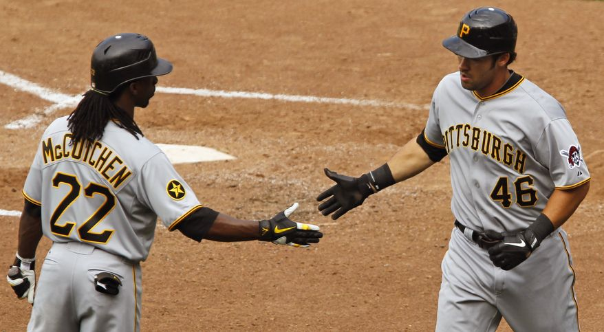 Pittsburgh Pirates' Andrew McCutchen, left, congratulates Garrett Jones after his solo home run off Washington Nationals' Sean Burnett during the eighth inning of the first baseball game of a doubleheader, Saturday, July 2, 2011, in Washington. The Pirates beat the Nationals 5-3. (AP Photo/Ann Heisenfelt)