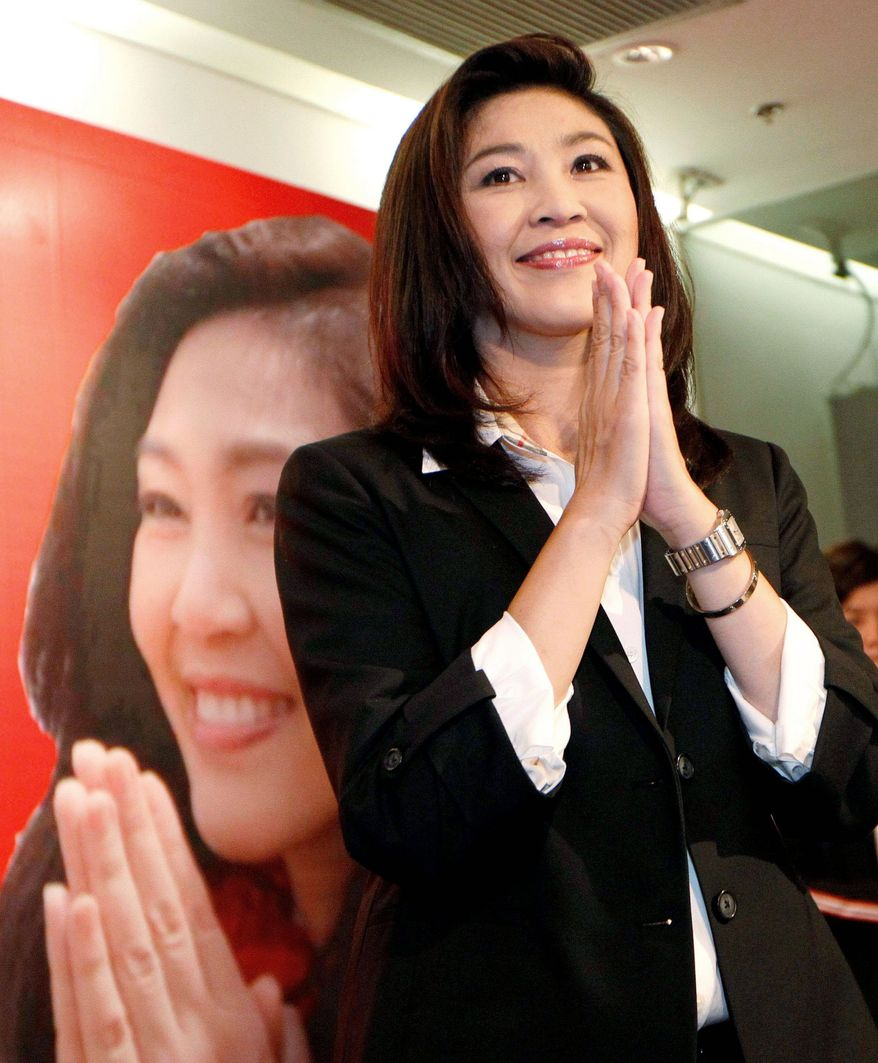 """Yingluck Shinawatra gives a traditional """"wai"""" greeting after a news conference. Her apparent victory paves the way for her to become Thailand's first female prime minister. (Associated Press)"""