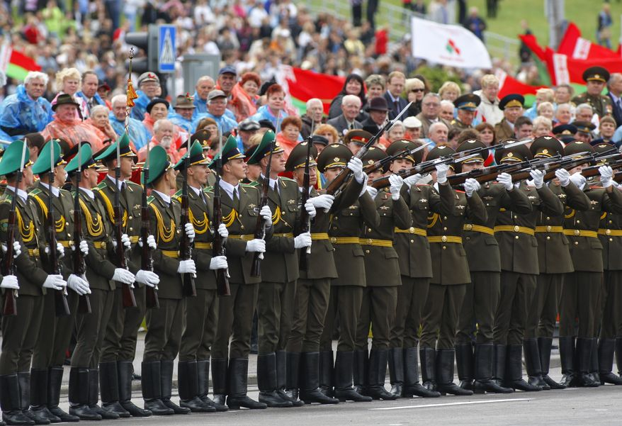 Belorussian honor guard soldiers perform during a parade marking Independence Day in Minsk, Belarus, on Sunday, July 3, 2011. Minsk was liberated by the Red Army from the Nazi invaders on this date in 1944. (AP Photo/Sergei Grits)