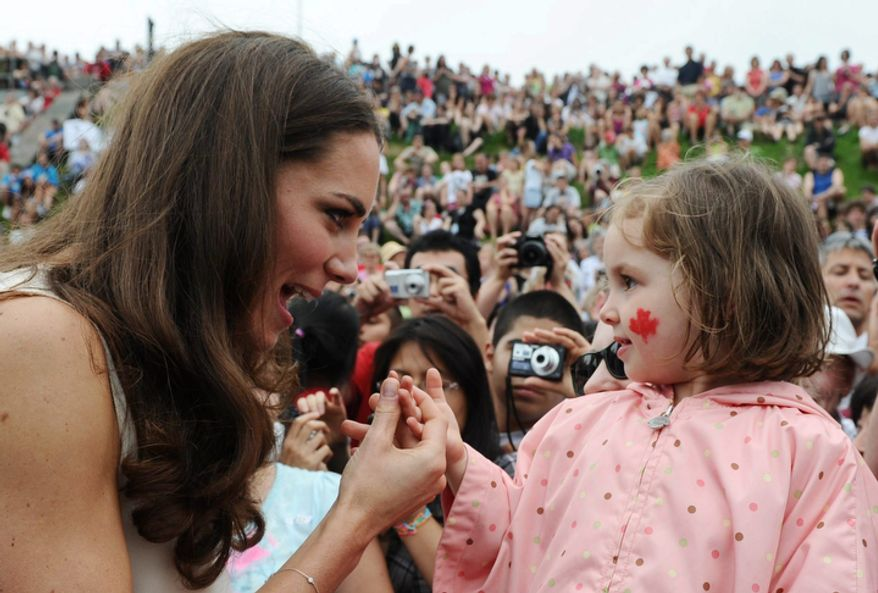 The Duchess of Cambridge, nee Kate Middleton, greets a girl during a visit to Fort Levis in Levis, Quebec, on Sunday, July 3, 2011. (AP Photo/The Canadian Press, Sean Kilpatrick)
