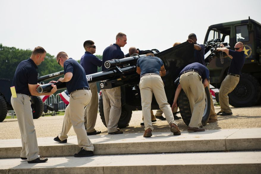 Members of the Old Guard Presidential Salute Battery move a cannon into position near the U.S. Capitol in Washington on Sunday, July 3, 2011, in preparation for Monday's Fourth of July celebration on the National Mall. (Drew Angerer/The Washington Times)