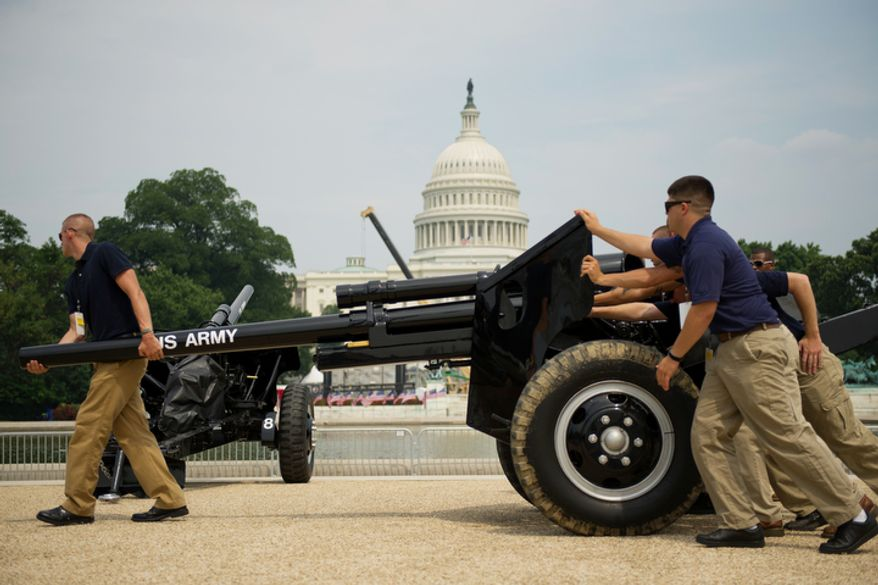 Members of the Old Guard Presidential Salute Battery move a cannon into position on the National Mall near the U.S. Capitol in Washington on Sunday, July 3, 2011, in preparation for Monday's Fourth of July celebration. (Drew Angerer/The Washington Times)