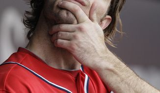 Washington Nationals' Jayson Werth stretches in the dugout during the second inning of an interleague baseball game against the Chicago White Sox in Chicago, Saturday, June 25, 2011. The White Sox won 3-0. (AP Photo/Nam Y. Huh)