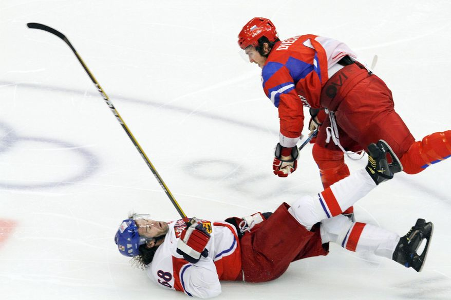 ASSOCIATED PRESS Alex Ovechkin's thunderous hit on Jaromir Jagr during Russia's game against the Czech Republic was the highlight-reel hit of the 2010 Winter Olympics. Jagr, a former Capital, is returning to the NHL to play for the rival Flyers.