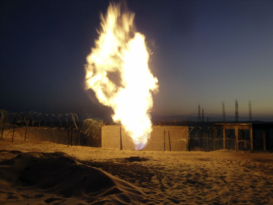Flames rise near El-Arish, Egypt, 30 miles from the border with Israel, on Monday, July 4, 2011, after unidentified assailants blew up the Egyptian pipeline that carries gas to Israel and Jordan. (AP Photo)