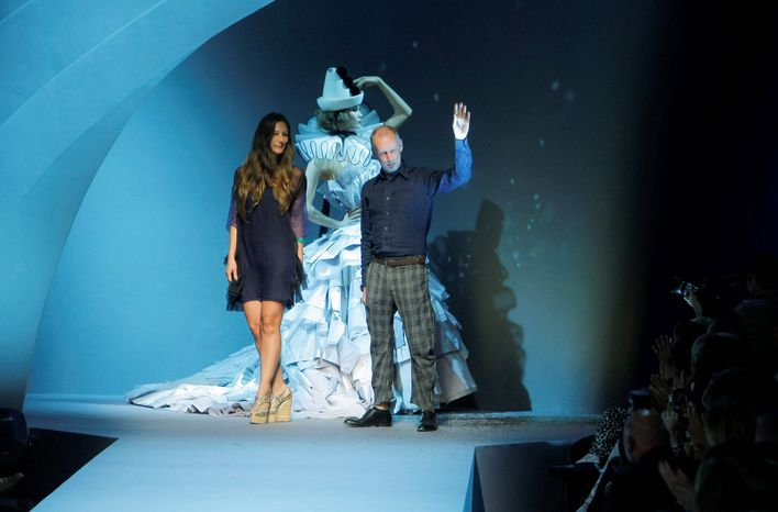 Bill Gaytton and Susanna Venegas (above) accept applause after Monday's debut of the Christian Dior Fall-Winter 2011-2012 collection (examples at right) in Paris. Mr. Gaytten was put in charge of fired artistic director John Galliano's signature line  last month, but Dior executives were quick to stress at the show that a permanent replacement had not been found. (Associated Press)