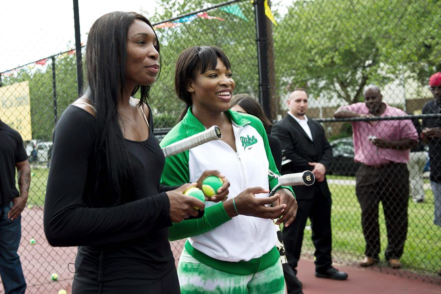 Venus (left) and Serena Williams, at the Southeast Tennis and Learning Center in April, are marquee players for the Washington Kastles, whose World TeamTennis season began Tuesday night. (Drew Angerer/The Washington Times)