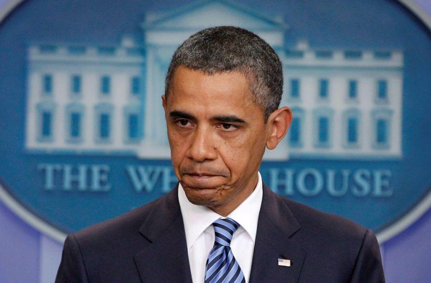 ** FILE ** President Obama prepares for budget talks. (Associated Press)
