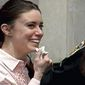 Casey Anthony smiles as she returns to the defense table after being acquitted of murder charges at the Orange County Courthouse in Orlando, Fla., Tuesday, July 5, 2011. (AP Photo/Pool)