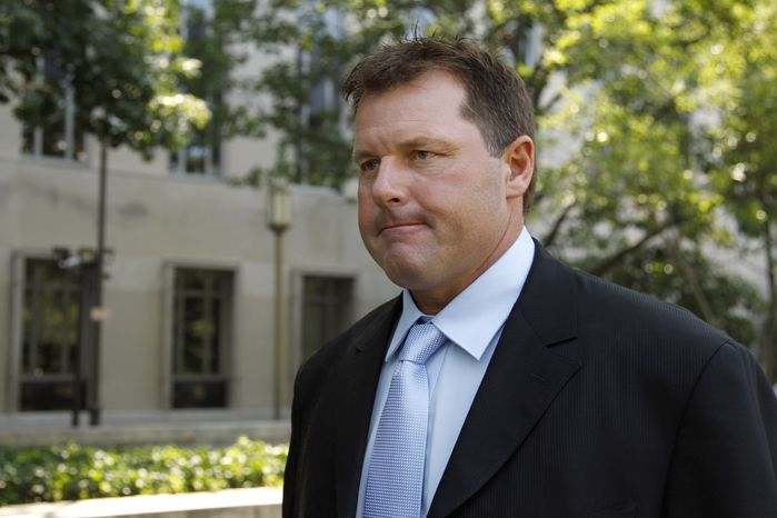 Roger Clemens leaves federal court in Washington on Tuesday. (AP Photo/Alex Brandon)