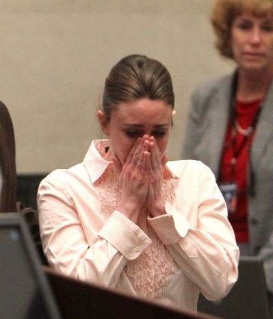 Casey Anthony reacts on Tuesday, July 3, 2011, at the Orange County Courthouse in Orlando, Fla., after a jury acquitted her of murdering her daughter, Caylee.