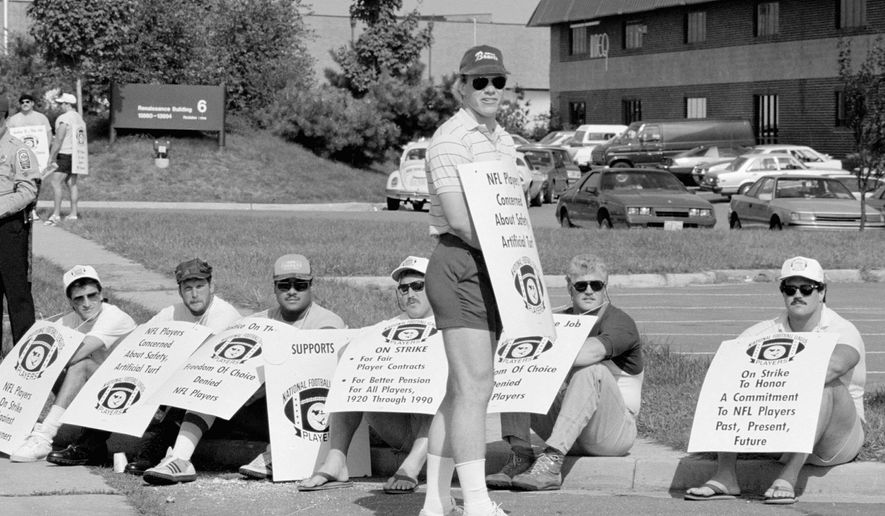 ASSOCIATED PRESS PHOTOGRAPHS Jay Schroeder and a host of Redskins teammates wore sandwich board strike signs outside the team's training facility Sept. 22, 1987. When running back Wayne Wilson (above right) and other replacement players took the field, Washington went 3-0 - including a 13-7 Monday night win over Dallas.