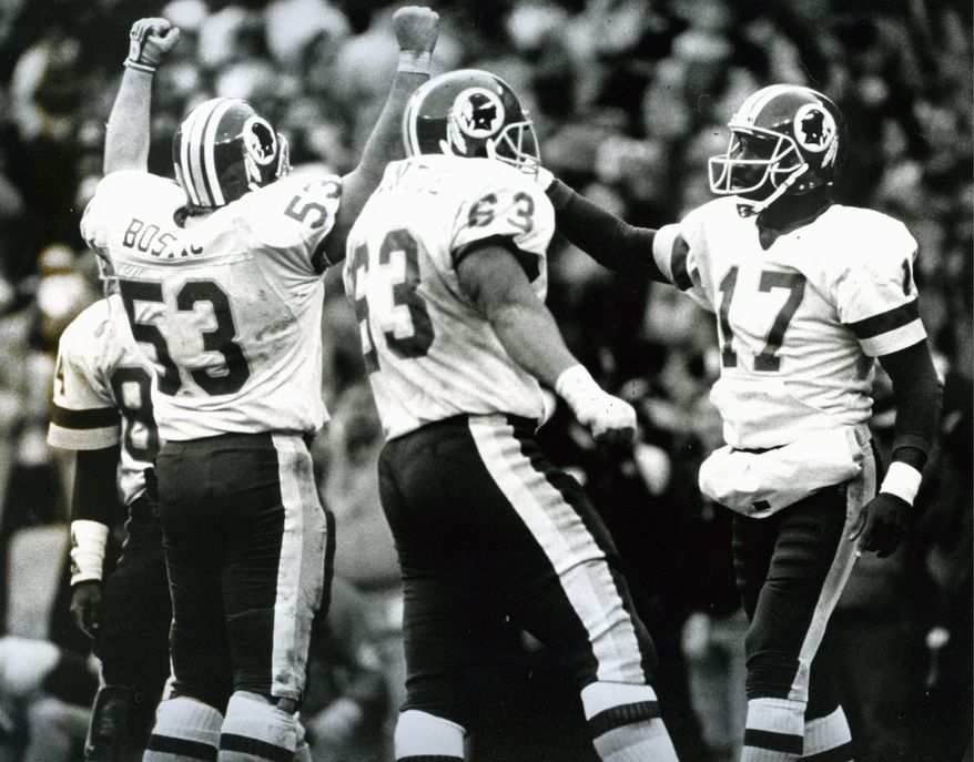 Redskins Jeff Bostic, Raleigh McKenzie and Doug Williams, left to right, celebrate their Super Bowl berth over the Vikings on Jan. 18, 1988. (Cathleen Curtis/The Washington Times)
