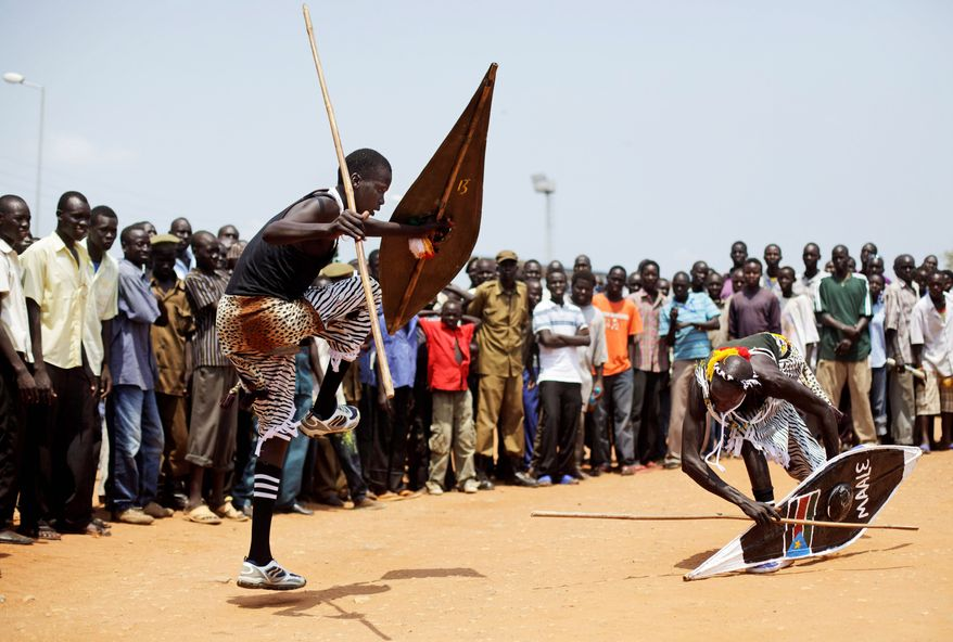 Nuer men perform for a crowd gathered Tuesday for independence celebration rehearsals in Juba, the capital of South Sudan, which becomes a nation on Saturday. Two decades of a north-south civil war left at least 2 million people dead. (Associated Press)