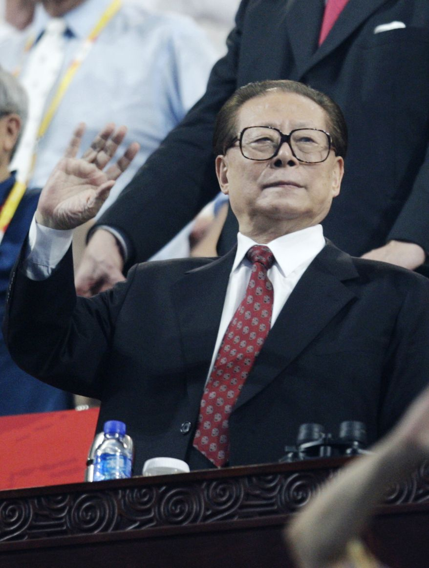 ** FILE ** Former Chinese President Jiang Zemin waves during the opening ceremonies of the 2008 Summer Olympics in Beijing. (AP Photo/Kevin Frayer)