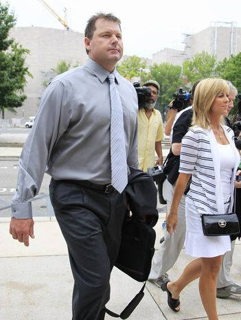 Former Major League Baseball pitcher Roger Clemens, left, with his wife Debbie Clemens, right, arrives at federal court in Washington, Wednesday, July 6, 2011, for his perjury trial. (AP Photo/Manuel Balce Ceneta)