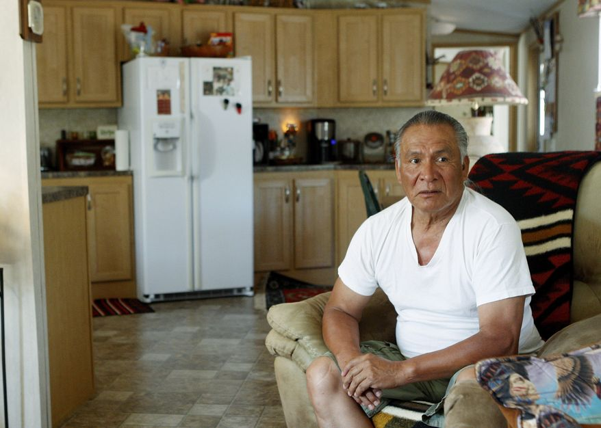 Charles Tiger is pictured during an interview in his FEMA trailer home in Little Axe, Okla., Thursday, June 16, 2011. Nearly six years after the hurricane, the mobile homes that became a symbol of the government's failed response are finally being put to good use. FEMA has quietly given many of them away to American Indian tribes that are in desperate need of affordable housing. (AP Photo/Sue Ogrocki)
