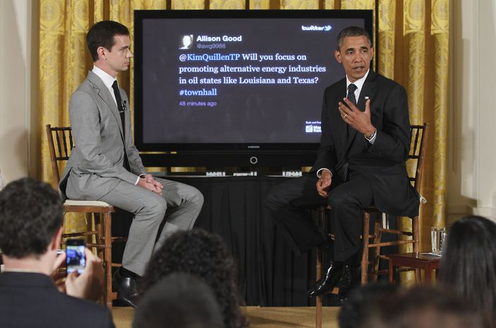 """President Barack Obama sits with Twitter co-founder and Executive Chairman Jack Dorsey during a """"Twitter Town Hall"""" in the East Room of the White House in Washington, Wednesday, July 6, 2011. (AP Photo/Charles Dharapak)"""