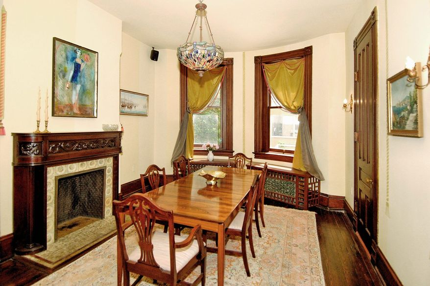The dining room has a fireplace, decorative radiator covers, a bow window and a dumbwaiter linked to the kitchen.