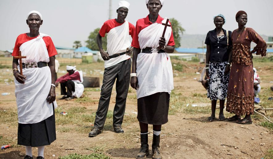 Residents of Jonglei state gather Thursday for a rehearsal of independence celebrations in Juba, southern Sudan. The new country is set to officially declare its separation from the north on Saturday. Sudanese President Omar Bashir, indicted for alleged war crimes, is expected to attend. (Associated Press)