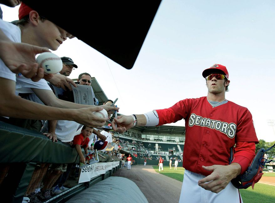 Harrisburg Senators' Bryce Harper signs autographs before a baseball game against the Erie SeaWolves, Wednesday, July 6, 2011, at Metro Bank Park, in Harrisburg, Pa. Harper's impressive stats earned the teenager a Fourth of July promotion Monday, moving on to Double-A as part of the Washington Nationals' measured approach with last year's No. 1 overall draft pick. (AP Photo/The Patriot-News, Chris Knight)