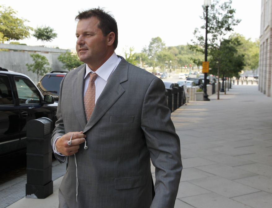 Former Major League Baseball pitcher Roger Clemens leaves federal court in Washington, Thursday, July 7, 2011, during jury selection in his trial on charges of lying to Congress in 2008 when he denied ever using performance-enhancing drugs. (AP Photo/Alex Brandon)