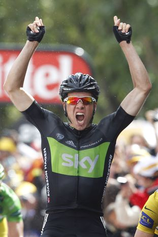 Edvald Boasson Hagen of Norway raises his arms as he crosses the finish line to win the sixth stage of the Tour de France cycling race over 226.5 kilometers (140.7 miles) starting in Dinan, Brittany, and finishing in Lisieux, Normandy, western France, Thursday July 7, 2011. (AP Photo/Christophe Ena)