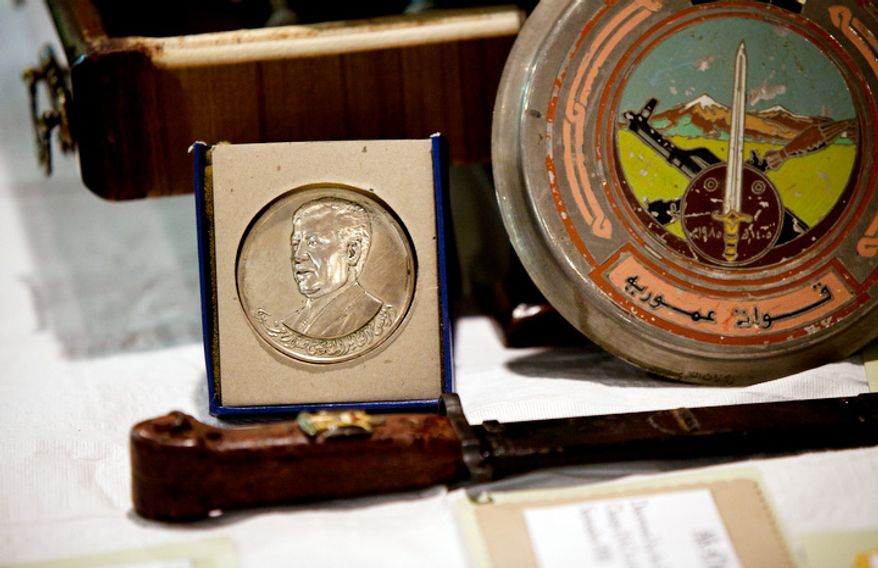 A coin is one of the many artifacts on display during a repatriation ceremony of Iraqi antiquities at the Iraqi Cultural Center in Washington on Thursday, July 7, 2011. (Pratik Shah/The Washington Times)