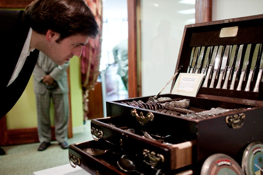 A guest looks at a chest of silverware on display during a repatriation ceremony of Iraqi antiquities at the Iraqi Cultural Center in Washington on Thursday, July 7, 2011. (Pratik Shah/The Washington Times)