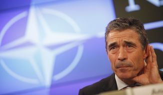 NATO Secretary-General Anders Fogh Rasmussen listens to a question during a media conference at the Residence Palace in Brussels on Wednesday, July 6, 2011. (AP Photo/Virginia Mayo)
