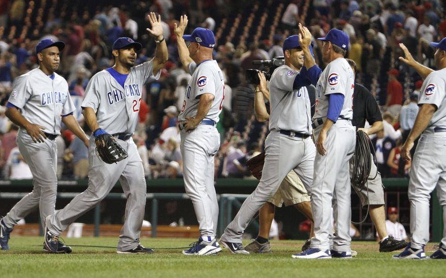 Chicago Cubs players celebrate after beating the Washington Nationals 10-9 on Thursday. The Nats blew an 8-0 lead, the largest in franchise history, in the loss. (AP Photo/Jacquelyn Martin)