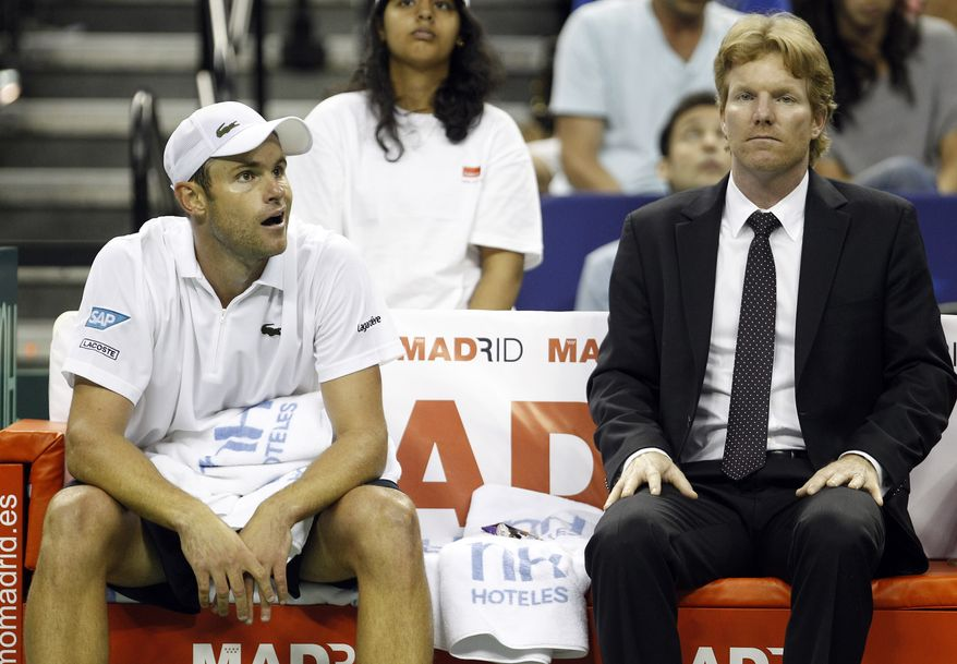 Andy Roddick of the U.S., left, and U.S. Davis Cup Captain Jim Courier react on the bench during a break against David Ferrer of Spain at the Davis Cup tennis quarterfinal match Friday, July 8, 2011 in Austin, Texas. Ferrer won 7-6, 7-5, 6-3. U.S. trails 2-0. (AP Photo/Eric Gay)