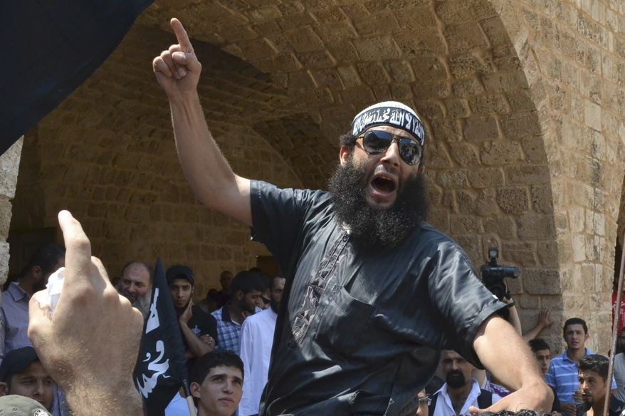 A Lebanese Salafist protester shout anti-Syrian regime slogans during a sit-in on July 8, 2011, in the northern city of Tripoli, Lebanon, after the Friday prayer to support Syrian protesters. (Associated Press)