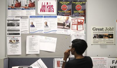 A job seeker looks at a bulletin at the Texas Workforce Commission's Workforce Solutions of Greater Dallas job resource center in Richardson, Texas, on July 5, 2011. (Associated Press)