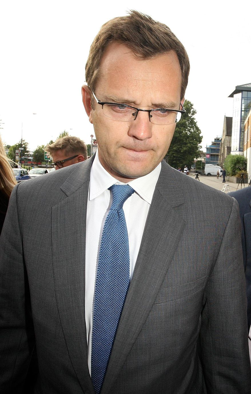Former Downing Street communication chief Andy Coulson speaks to members of the media as he leaves Lewisham police station in south London, after being arrested in a phone hacking and police corruption scandal, Friday July 8, 2011. (AP Photo/PA, Dominic Lipinski)