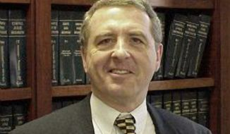 In this undated photo released by the United States District Court , U.S. Magistrate Judge Arthur J. Boylan poses for a photograph. Critical thinking and an ability to relate to others plays a big role in the courtroom for Boylan, who is no doubt having those skills tested as he tries to diffuse the tension in the NFL lockout, no more than 100 days long. (AP Photo/United States District Court)