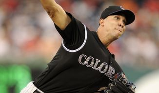 Colorado Rockies starting pitcher Ubaldo Jimenez allowed one run in eight innings in the 2-1 win over the Washington Nationals on Saturday night. (AP Photo/Nick Wass)