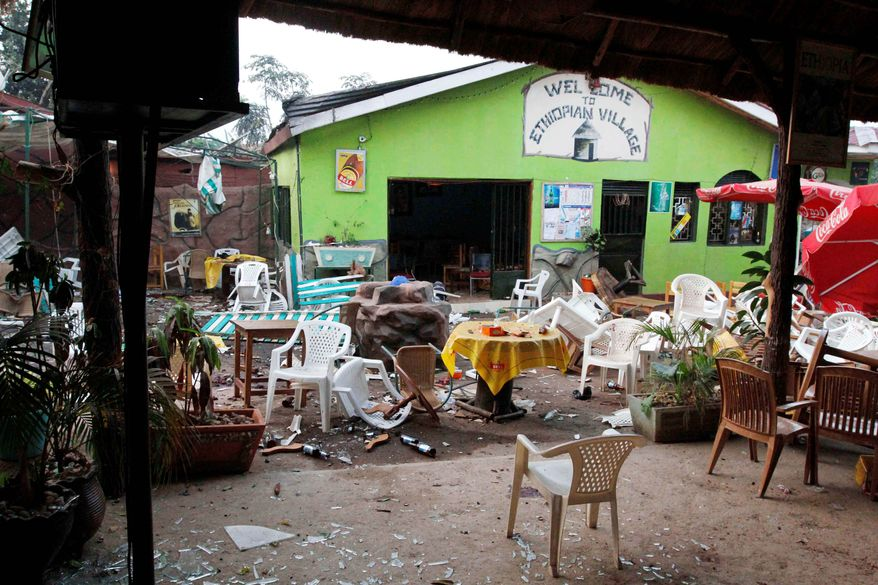 Damaged tables and chairs are among the debris strewn outside a restaurant in Kampala, Uganda, on July 12, 2010, after an explosion the day before. Simultaneous al-Shabab-linked blasts tore through crowds watching the World Cup final at a rugby club and the restaurant, killing 78. (Associated Press0