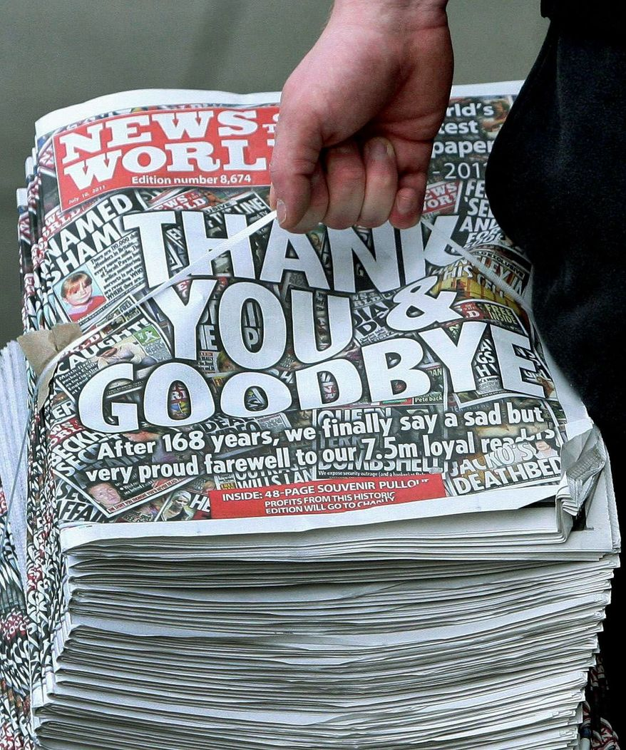 A bundle of the final printing of the News of the World newspaper arrives at a shop in Stockport, England on Sunday. Britons snapped up the last edition of Britain's best-selling Sunday tabloid after the 168-year-old paper was brought down in a phone-hacking scandal. (Associated Press)