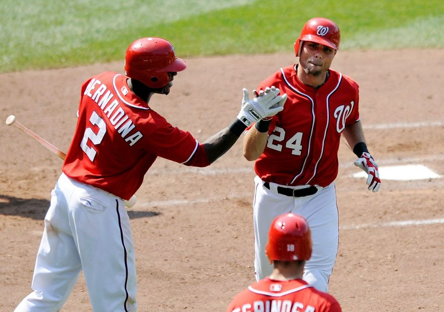 Rick Ankiel (24) is congratulated by Roger Bernadina after his eighth-inning pinch-hit homer gave the Nationals breathing room. (Associated Press)