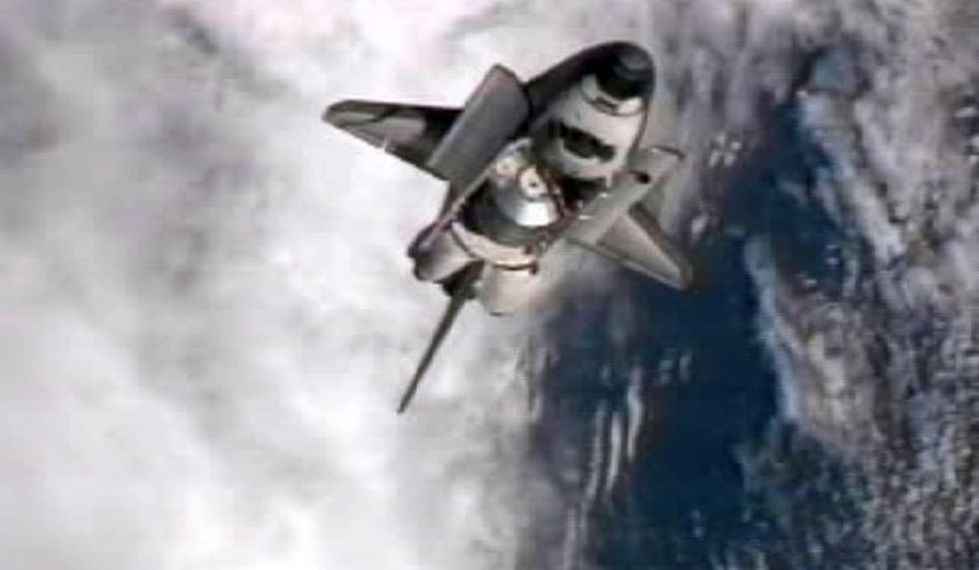 A frame grab from NASA-TV shows space shuttle Atlantis performing a pitch maneuver as it closes in for one last docking at the International Space Station on Sunday, July 10, 2011. (AP Photo/NASA)