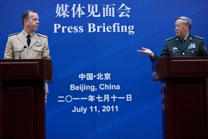 China's Gen. Chen Bingde (right) and Adm. Mike Mullen, who is on a four-day visit to China, disagree on the propriety of American naval exercises with its allies on the South China Sea. (Associated Press)