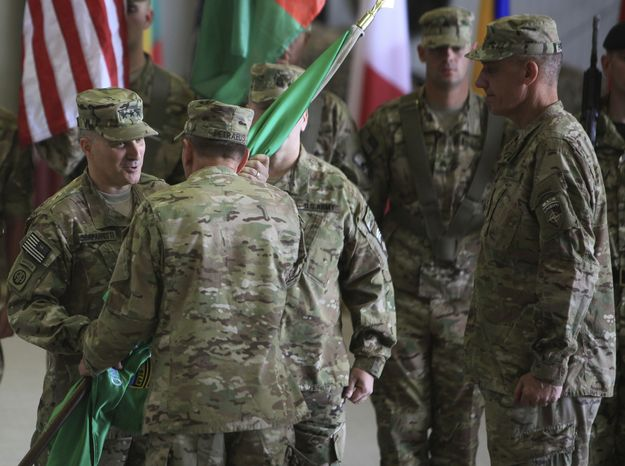 ** FILE ** Lt. Gen. Curtis Scaparrotti (left) receives a flag from Gen. David H. Petraeus (second from left) as Lt. Gen. David M. Rodriguez (right) looks on during a change of command ceremony in Kabul, Afghanistan, on Monday, July 11, 2011. (AP Photo/Rafiq Maqbool)
